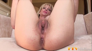 Milf shows huge clitoris