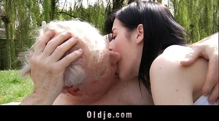 Young brunette hair bitch copulates with grandad in the park