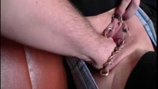Fist fucking her heavily pierced gaping pussy